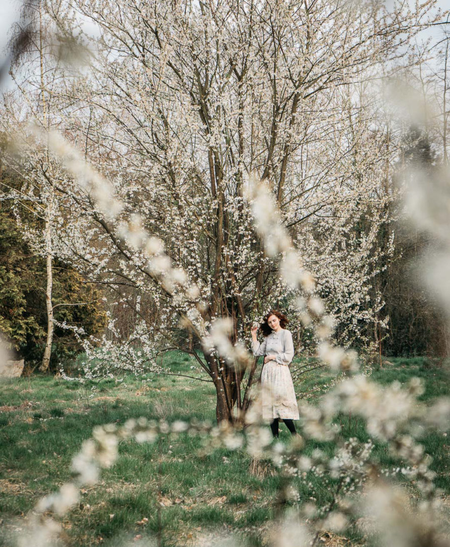 Girl under a blossoming tree in April