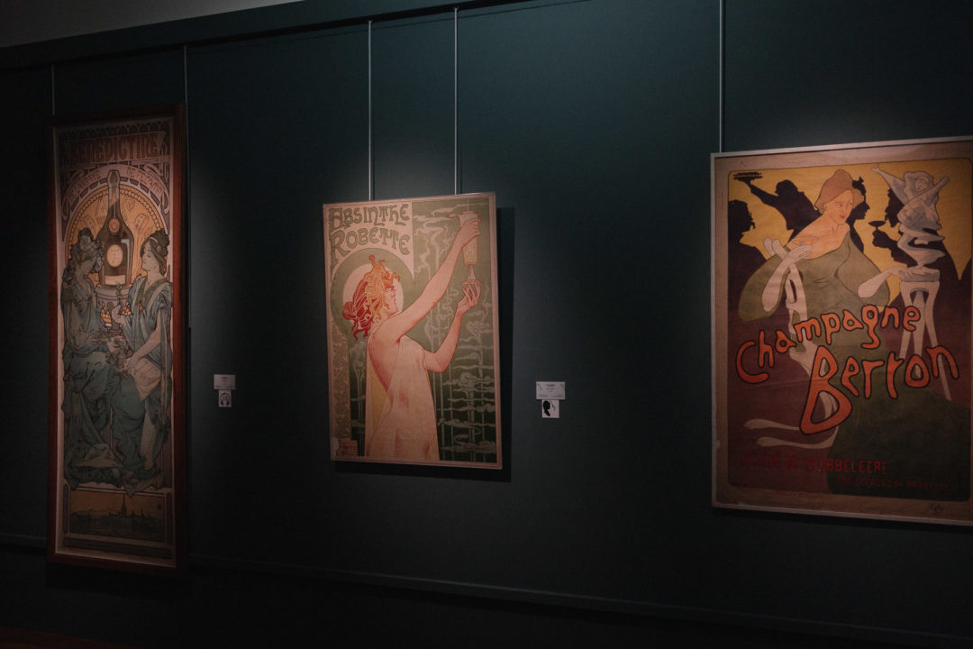 Three Art Nouveau paintings hanging on a wall