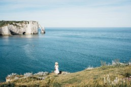 Girl overlooking the cliffs of Étretat