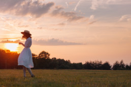 Girl dancing against the sunset