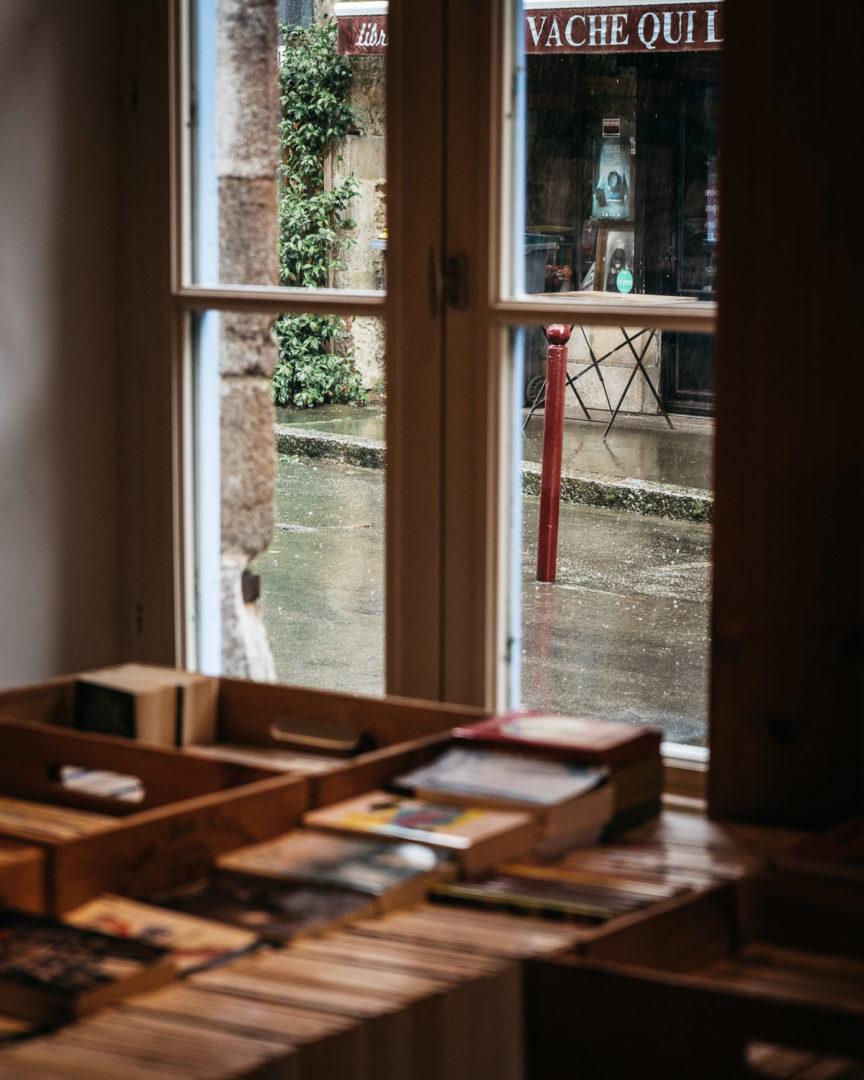 Rain outside the window of a bookstore
