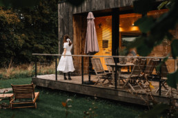 Girl in a dress in front of a passive eco-house