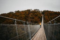 Girl in a raincoat on the Geierlay bridge