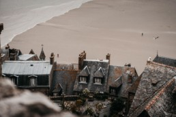 Tide coming in behind the houses of Mont Saint-Michel