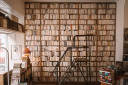 Endless rows of books inside a secondhand bookstore