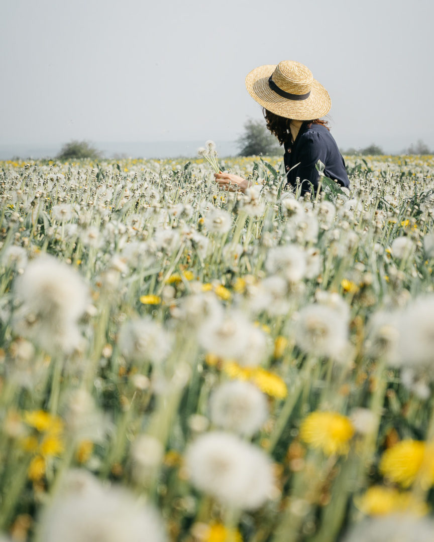 Girl with a hat in a daffodil meadow
