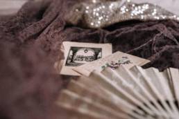 Antique fan, old postcards and a madame shoushou dress thrown together