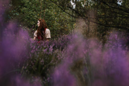 Woman sitting in a field of heather