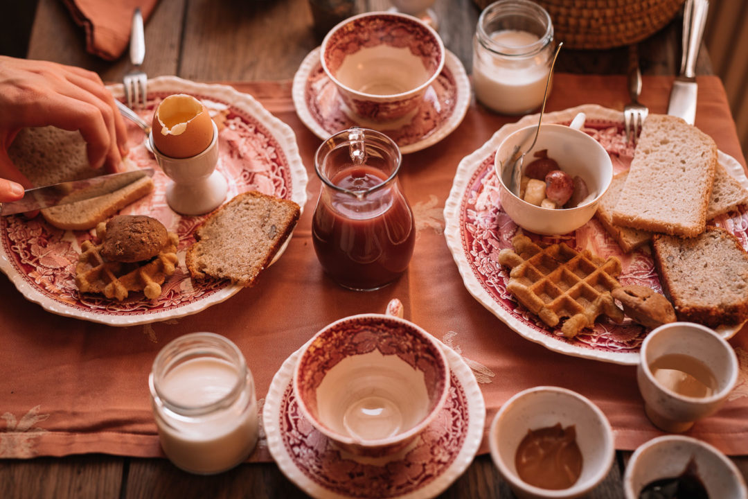 Returning to Aux Quatre Bonnier for another delicious homemade breakfast, plates filled with savory and sweet treats.
