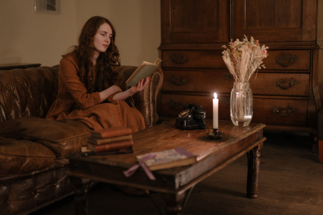 Returning to Aux Quatre Bonniers and relaxing in front of the fire with a stack of books.