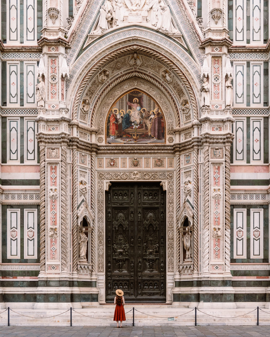 woman standing in front of santa maria del fiore in florence