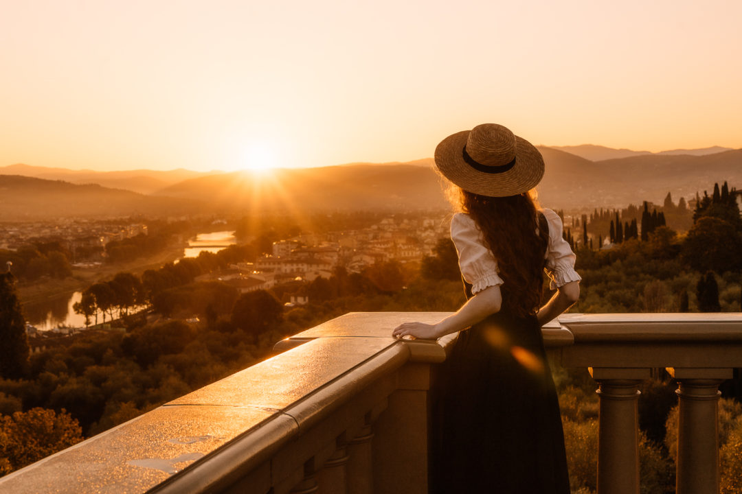 woman overlooking the sunrise in florence